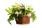 Bouquet of fresh lilies in basket isolated on white background — Stock Photo