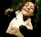 Huge dog biting the girl. Stylized photo — Stock Photo