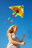 Blonde girl and flying kite — Photo