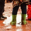 Stock Photo: Children are playing in muddy puddles