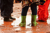 Children are playing in muddy puddles — Stock Photo