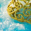 Golden Christmas ornament in the snow — Stock Photo