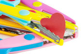 Cutting of red paper heart on a white background — Stok fotoğraf