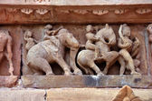 Carving of ancient warriors, elephents and horses on the battle — Stock Photo