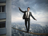 Equilibrist businessma — Stock Photo