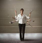 Multitasking woman in kitchen — Stock Photo