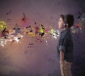 Young boy listening to music — Stok fotoğraf