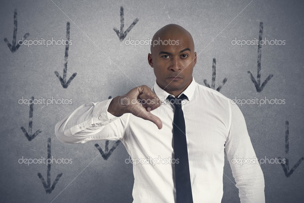 Concept of unhappy businessman with down arrow — Stock Photo #21107401