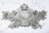 Antique silver emblem — Stock Photo