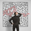 Confused business man seeks a solution to the labyrinth — Stock Photo #29017459