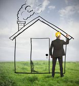 Architect drawing home — Stock Photo