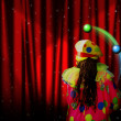 Stock Photo: Red curtain of stage with stars and juggler clown