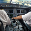 Stock Photo: Pilot on airplane