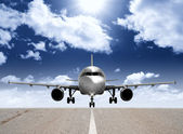 Airplane in the runway — Stock Photo