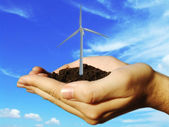 Wind eolic turbine in hands — Stock Photo
