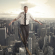 Equilibrist businessman — Stock Photo #31444789
