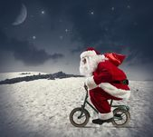 Santa claus on the bike — Stock Photo