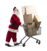 Santa Claus with shopping cart — Stock Photo