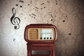 Vintage music notes with old radio — Stock Photo