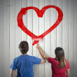 Couple drawing a heart — Stock Photo