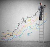 Businessman draws statistics — Stock Photo
