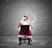 Santa Claus with laptop — Stock Photo