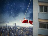 Climbing Santa Claus — Stock Photo