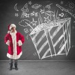 Child dreams christmas gifts — Stock Photo