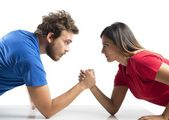 Arm wrestling between a couple — Stock Photo