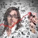 Businesswoman draws modern business concept — Stock Photo