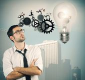Businessman powering a big idea — Stock Photo