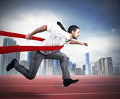 Successful businessman in a finishing line — Stock Photo