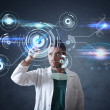 Doctor with futuristic touchscreen interface — Stock Photo