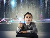 Young boy looking for malicious code — Stock Photo