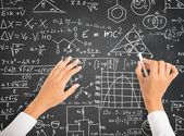 Science and math formulas on chalkboard — ストック写真
