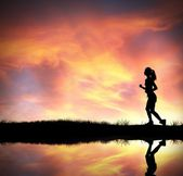 Silhouette of running girl — Stock Photo