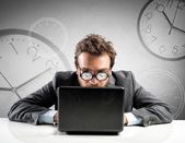Internet addiction concept with clock in glasses — Stock Photo