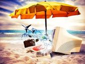 Vacation time with computer on beach — Stock Photo
