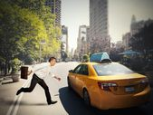 Businessman and taxi — Stock Photo