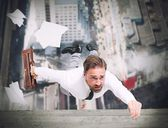 Businessman is going to fall — Stock Photo