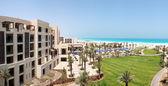 Panorama of swimming pools and beach at the luxury hotel, Saadiy — Stock Photo