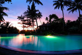 Sunset and illuminated swimming pool, Bentota, Sri Lanka — Stock Photo