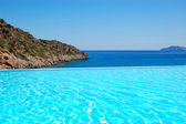 Infinity swimming pool with a view on Aegean Sea at the luxury h — Stok fotoğraf