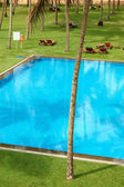 The swimming pool and green lawn at luxury hotel, Bentota, Sri L — Stock Photo