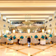 Lobby interior of the luxury hotel in night illumination, Ras Al — Stock Photo