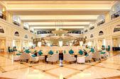 Lobby interior of the luxury hotel in night illumination, Ras Al — Stock Photo