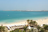 Beach with a view on Jumeirah Palm man-made island, Dubai, UAE — Stok fotoğraf