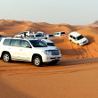 DUBAI, UAE - SEPTEMBER 12: The Dubai desert trip in off-road car — Stock Photo #32910589