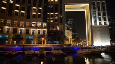 The night illumination of Dubai Marina. It is an artificial canal city, built along a two mile (3 km) stretch of Persian Gulf shoreline. Dubai, UAE — Stock Video