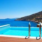 The sea view swimming pool at the luxury villa, Crete, Greece — Stock Photo #35068545